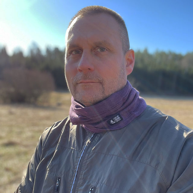 Neck Tube Merino Wool Purple from TAC-UP GEAR around neck on man