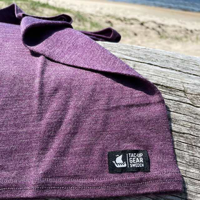Neck Tube Merino Wool Purple from TAC-UP GEAR on a log