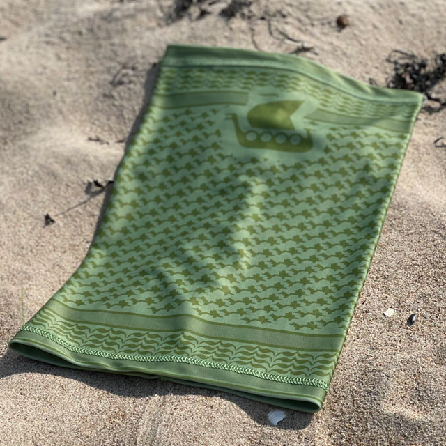 Neck Tube Shemagh Lime Green from TAC-UP GEAR lying flat on sand