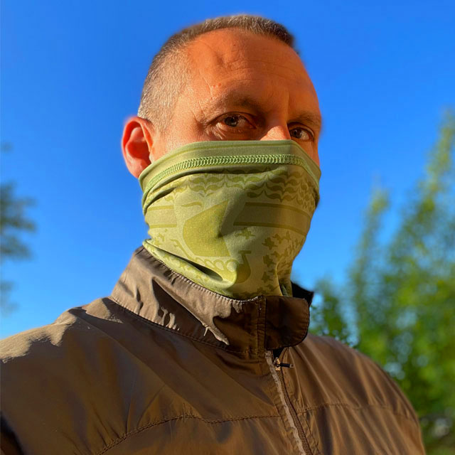 A Neck Tube Shemagh Lime Green from TAC-UP GEAR worn around nose and mouth on a model