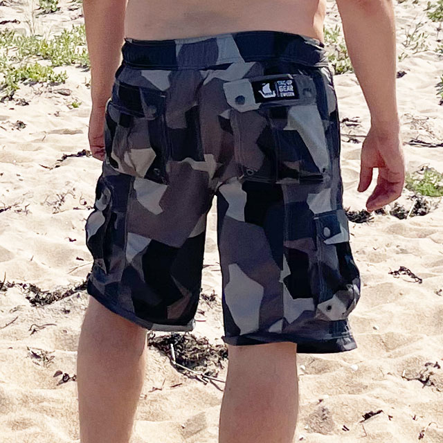 NEPTUNE Shorts M90 Grey worn in the sun on the beach seen from the back