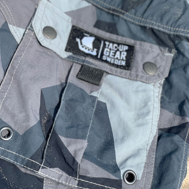 NEPTUNE Shorts M90 Grey closeup on back pocket with Tac-Up Gear logo on lid