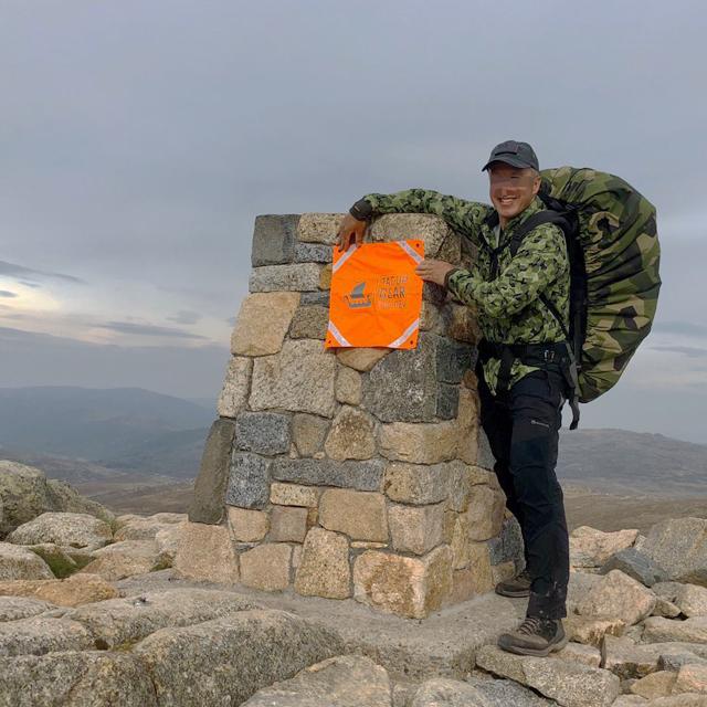 Orange Ruck Signal Panel Marker on the top of Australias highest mountain