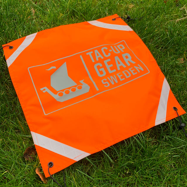 Orange Ruck Signal Panel Marker seen from the side.