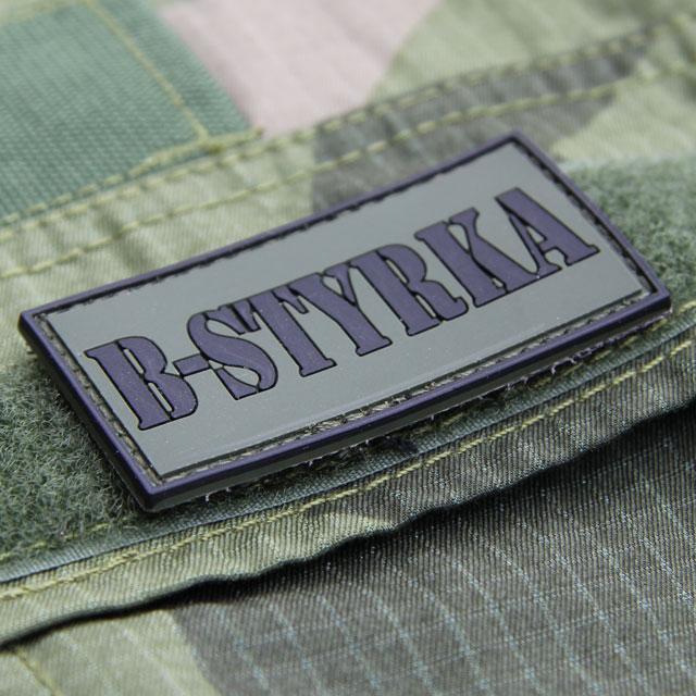 A B-Styrka PVC Patch mounted on the pocket lid of a Field Shirt M90.