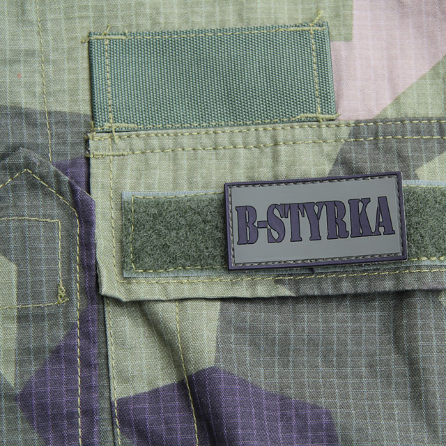 A B-Styrka PVC Patch used to complement a Field Shirt M90.