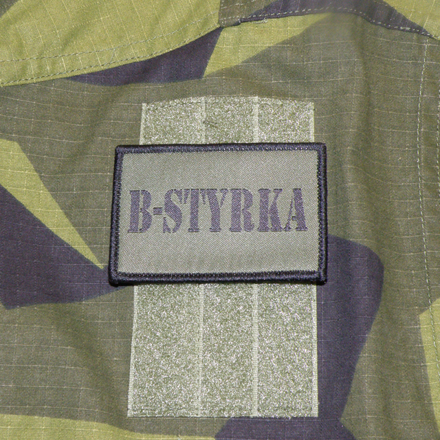 B-Styrka Hook Green Patch mounted on a arm of a M90 jacket.