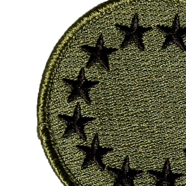 Close up of a EU Green Embroidered Patch.