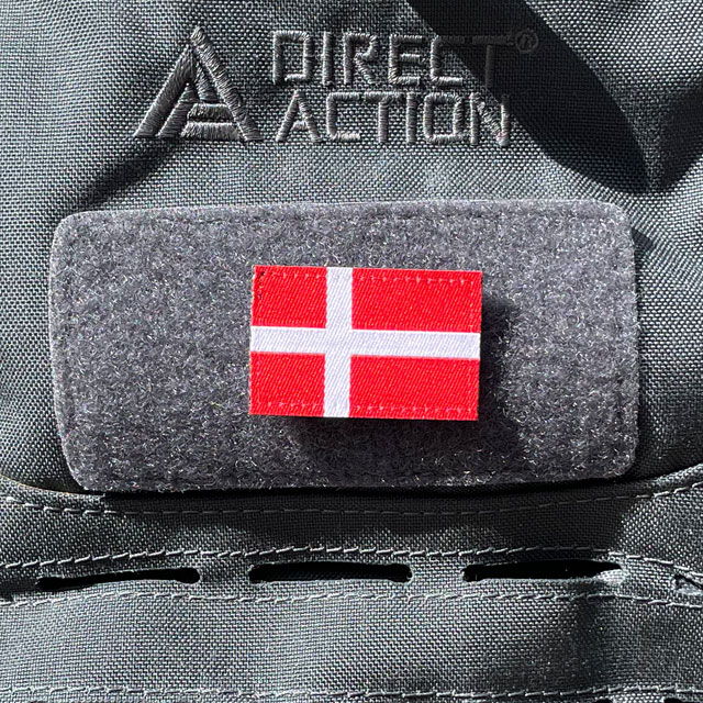 A Denmark Flag Hook Patch Small from TAC-UP GEAR mounted on a grey rucksack
