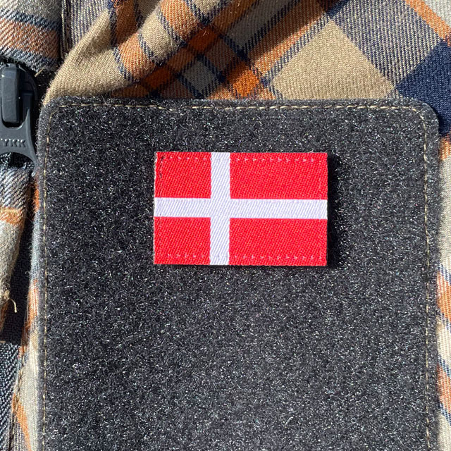 A Denmark Flag Hook Patch Small from TAC-UP GEAR mounted on velcro sleeve