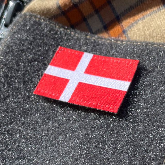 A closer look on a Denmark Flag Hook Patch Small from TAC-UP GEAR mounted on velcro sleeve