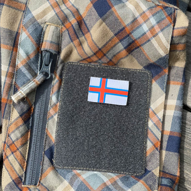A Faroese Flag Hook Patch Small mounted on a shirt