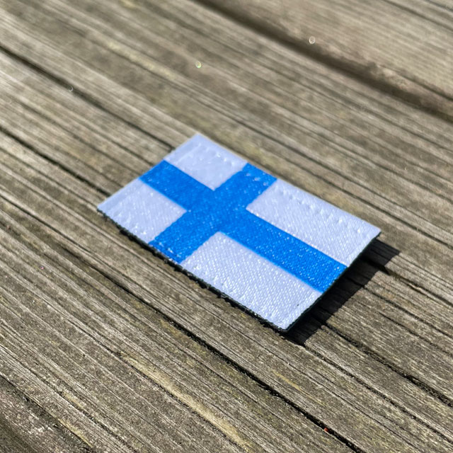 A Finland Flag Hook Patch Small from TAC-UP GEAR seen from an angle