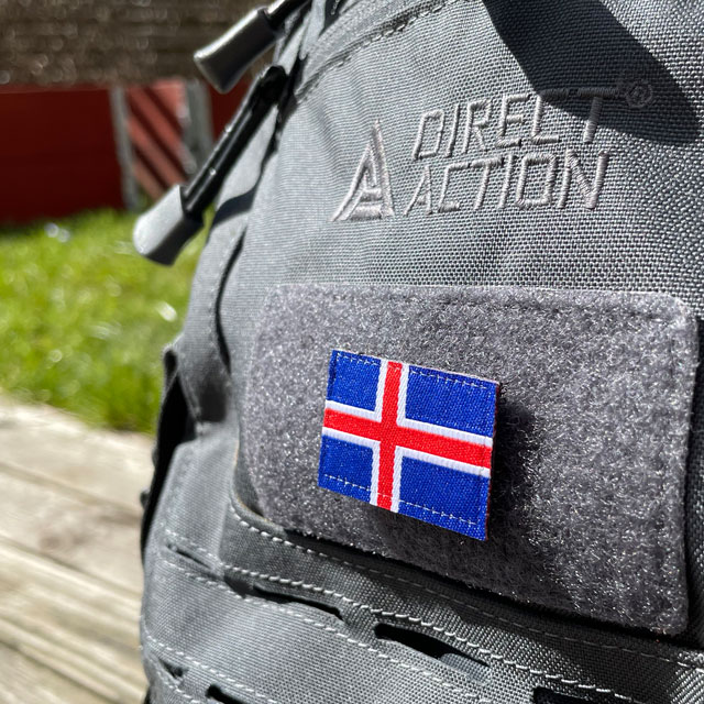 A Iceland Flag Hook Patch Small from TAC-UP GEAR mounted on velcro sleeve on a rucksack seen from an angle