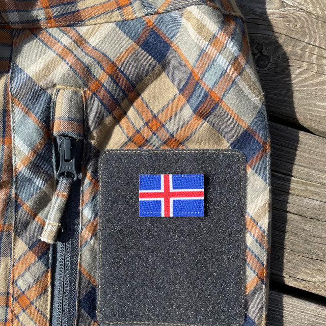 A Iceland Flag Hook Patch Small from TAC-UP GEAR mounted on velcro sleeve on a shirt