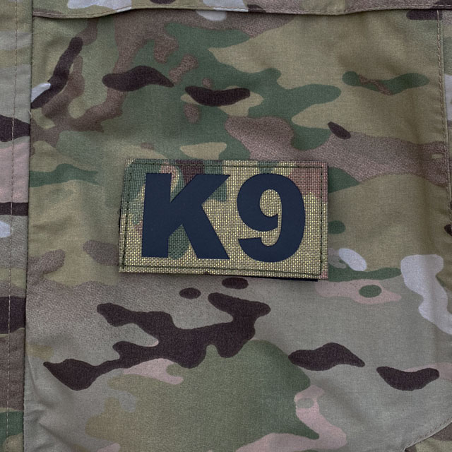 IR - K9 Multicam Hook Patch lying on a Multicam Jacket
