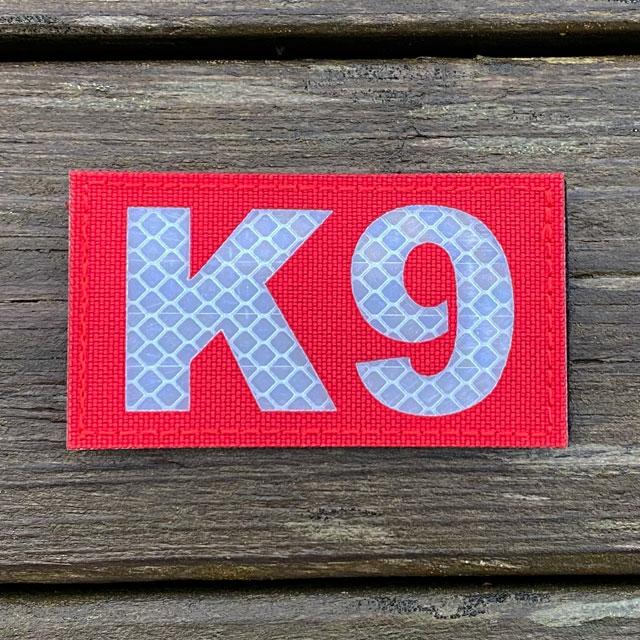 IR - K9 Red Hook Patch lying flat on wooden floor