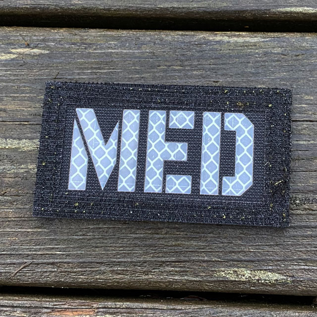 Black side up on a IR - MED Black-Green Reversible Glow Hook Patch