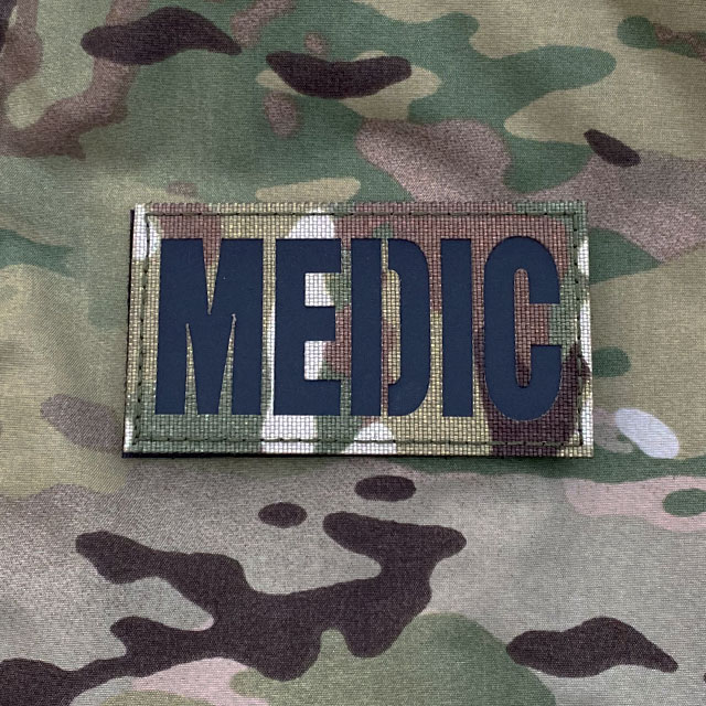 A IR - MEDIC Multicam Hook Patch on a Multicam jacket