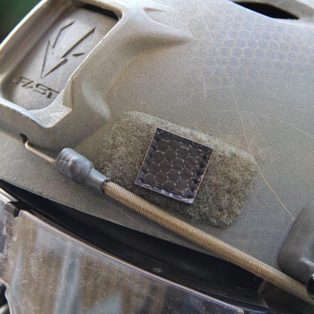 A IR Tactical Glint Square - 2 cm mounted on an Ops Core Helmet for IR recognition.