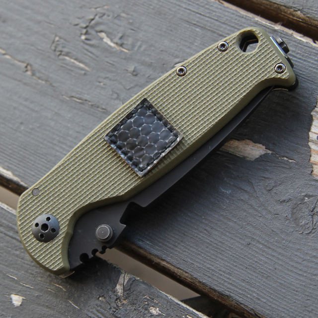 The smallest patch included in the IR Tactical Glint Square x 6 Bundle on a knife for size comparison.