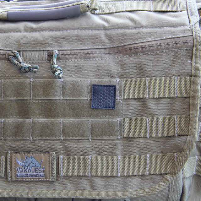 A IR Tactical Glint Square - 3 cm mounted on a messengerbag.