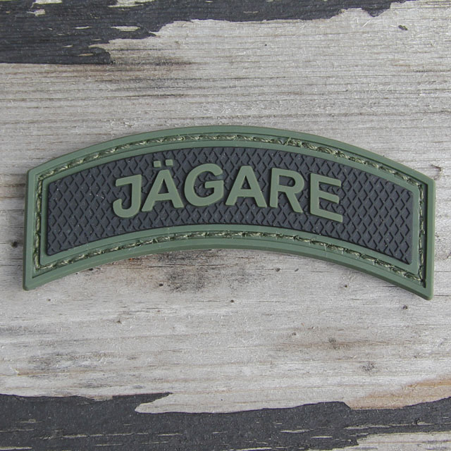 Wood background and JÄGARE Green/Black PVC Patch M15.