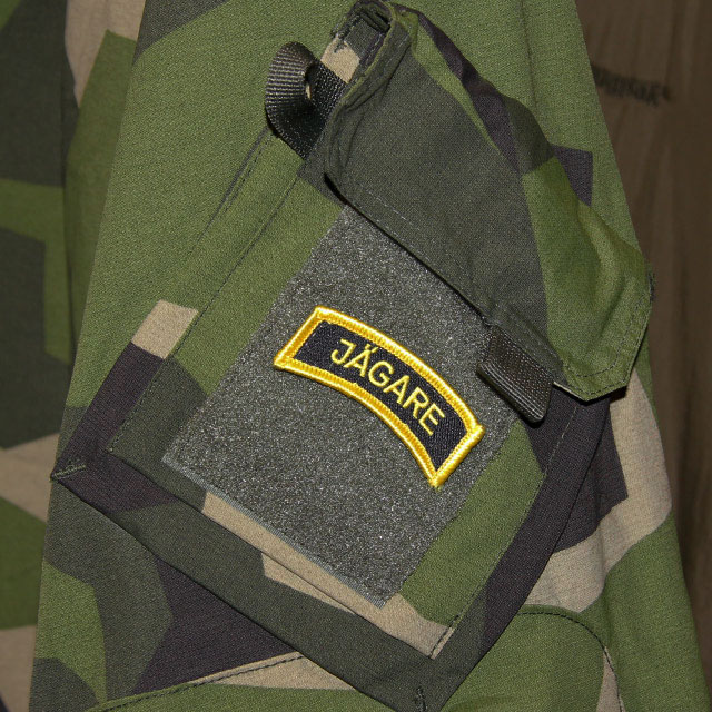 A Mounted JÄGARE Hook Patch Yellow/Black/Yellow on a M90 NCWR Jacket arm.
