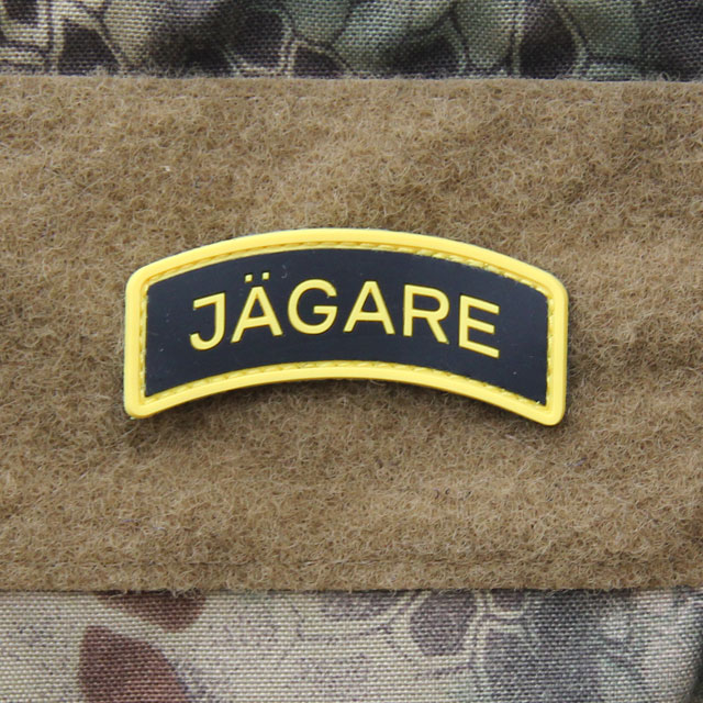 A mounted JÄGARE Yellow/Black/Yellow PVC Patch.