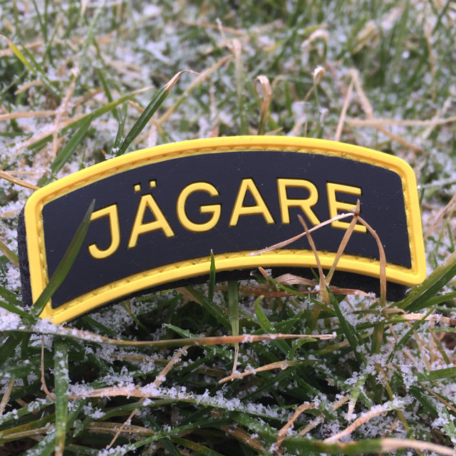 Frosty grass and a JÄGARE Yellow/Black/Yellow PVC Patch.