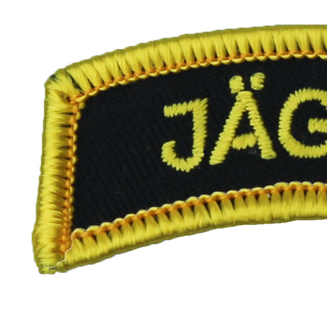 Close up of a JÄGARE Patch Yellow/Black/Yellow.