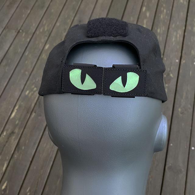 Lynx Glow Eyes Black Hook Tube mounted on a black cap