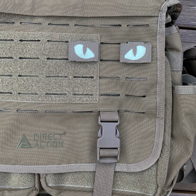 A pair of Lynx Glow Eyes Green Hook Tube mounted on a messenger bag from Direct Action
