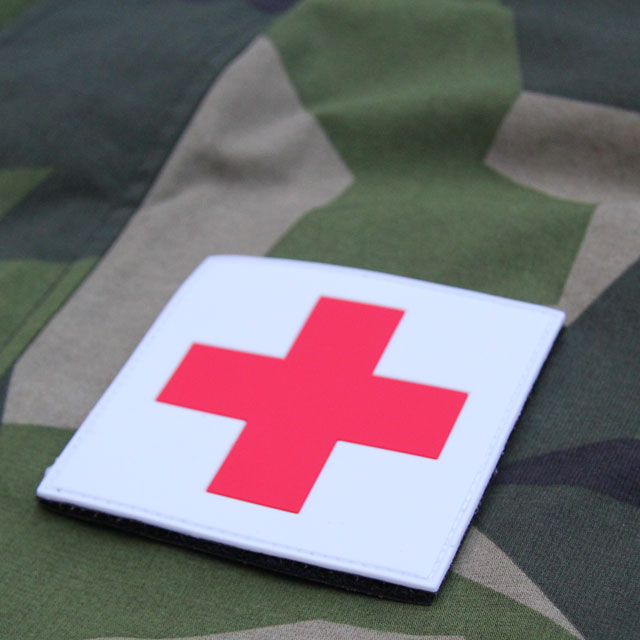 M90 camouflage background and a Medic Cross PVC Hook Patch.