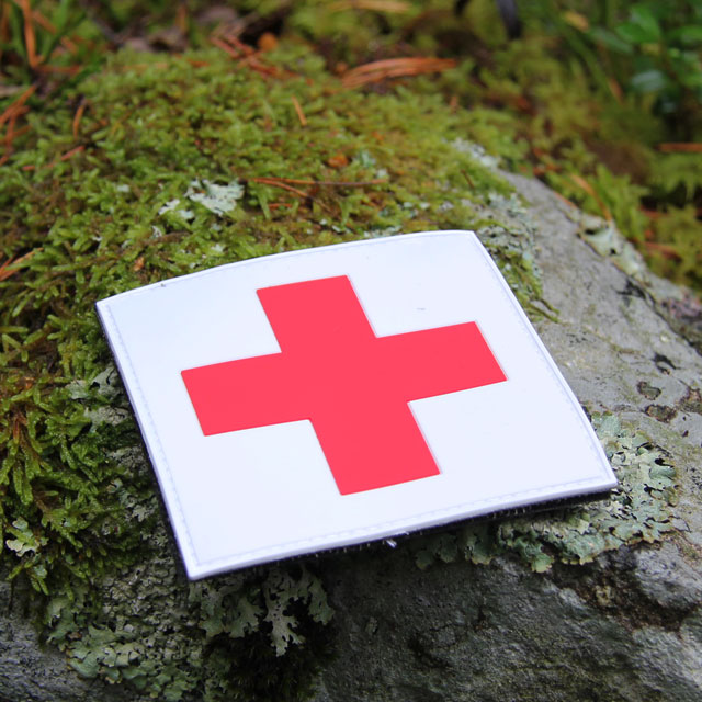 Stony background and a Medic Cross PVC Hook Patch.