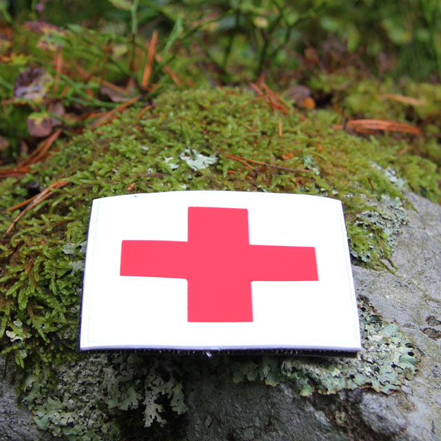 Swedish autumn stone with a Medic Cross PVC Hook Patch.