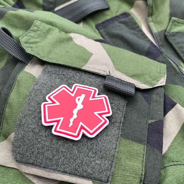Arm pocket of a NCWR M90 Jacket and a MEDIC PVC Star Red White Hook Patch.