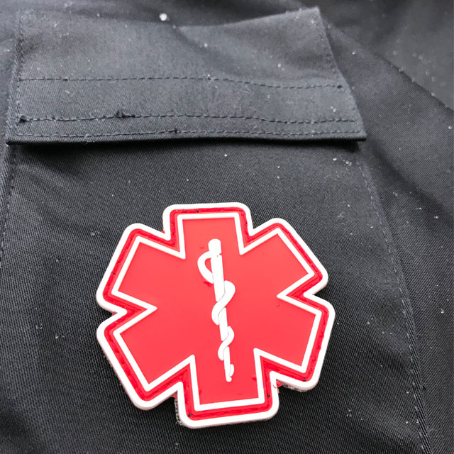 Blue background and a MEDIC PVC Star Red White Hook Patch.