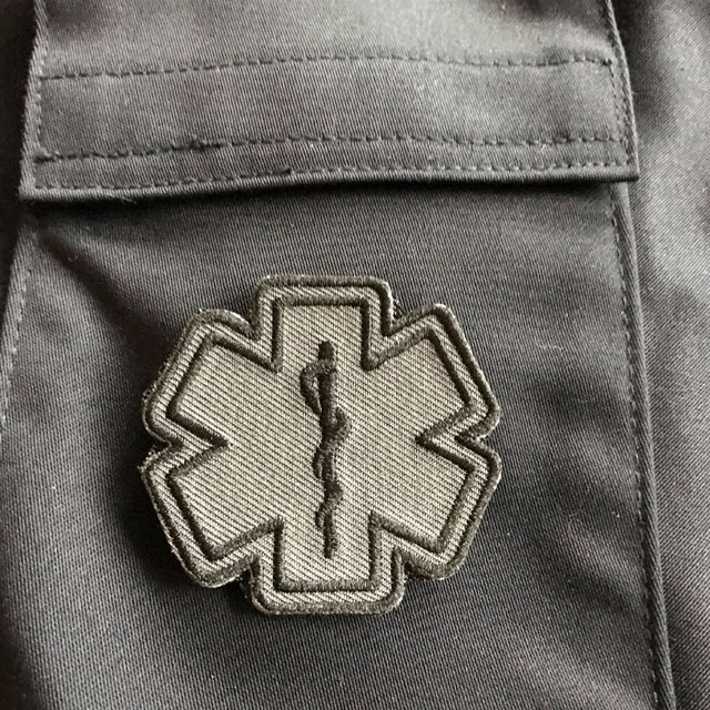 Blue background and a MEDIC Star of Life Black Grey Hook Patch.
