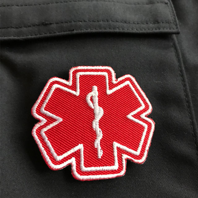 MEDIC Star of Life Red White Hook Patch on blue jacket.