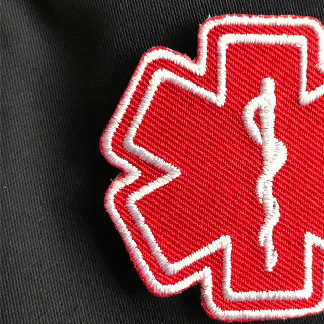 Detailed view of a MEDIC Star of Life Red White Hook Patch.