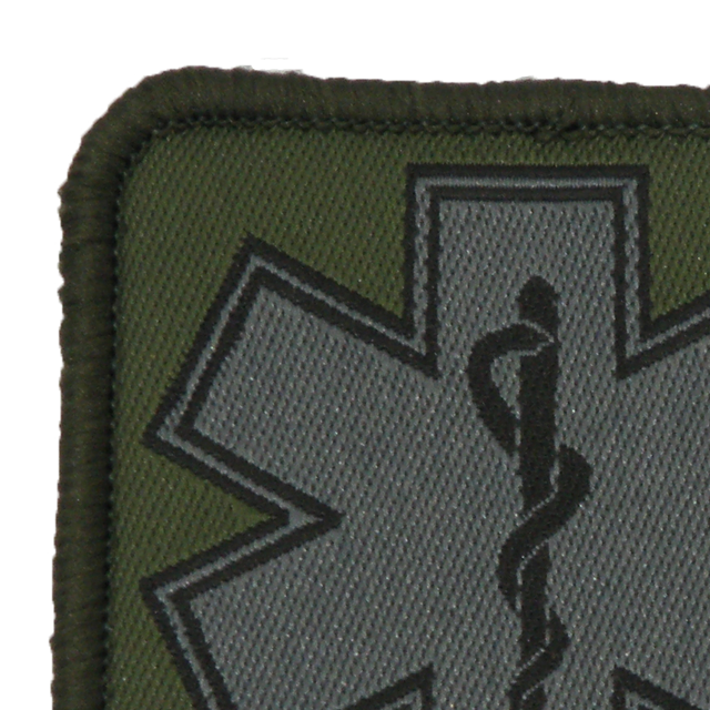 Close up of a MEDIC Subdued Green Star Patch.