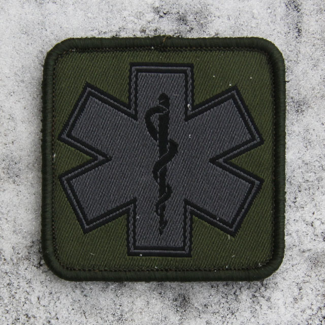 MEDIC Subdued Green Star Patch on frosty background.