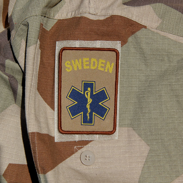 M90K Desert Camouflage background and a SWE MEDIC Desert Star Hook Patch.