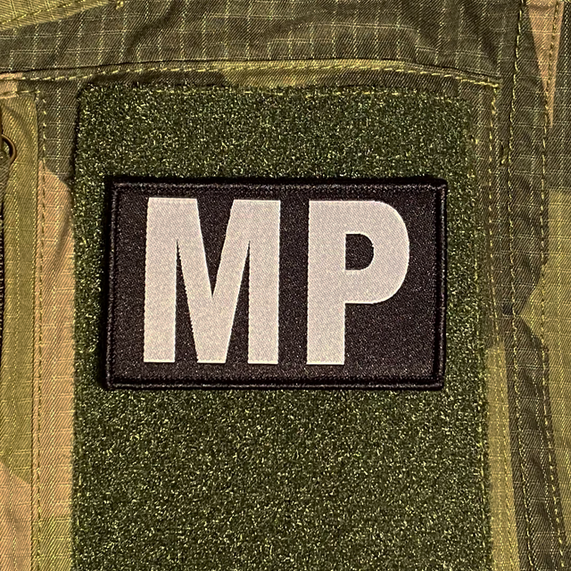 Militärpolis Patch mouted on a M90 camouflage shirt sleeve
