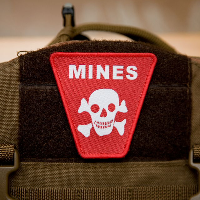 Mines Hook Morale Patch mounted on a rucksack.
