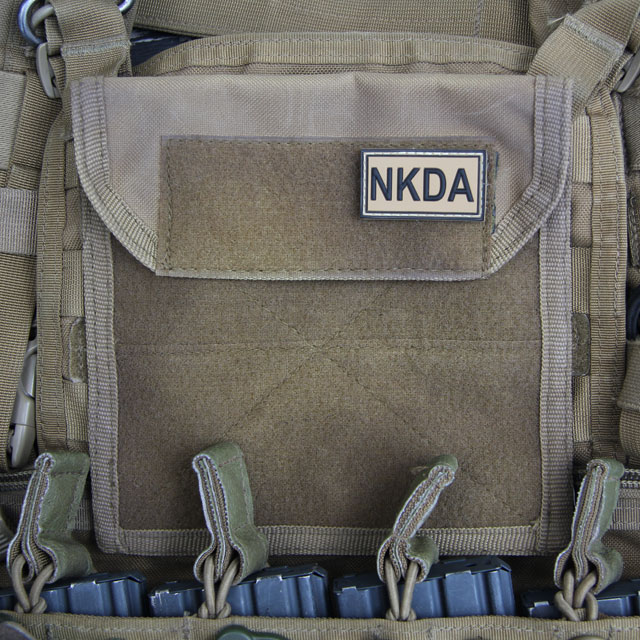 NKDA Desert Hook PVC Patch on a coyote plate carrier