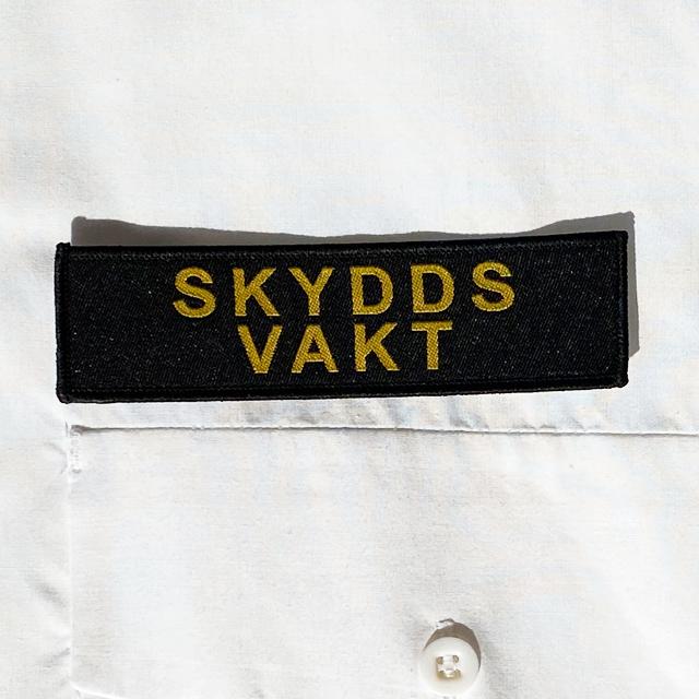 Skyddsvakt Avlångt Tygmärke att sy på tex en skjorta