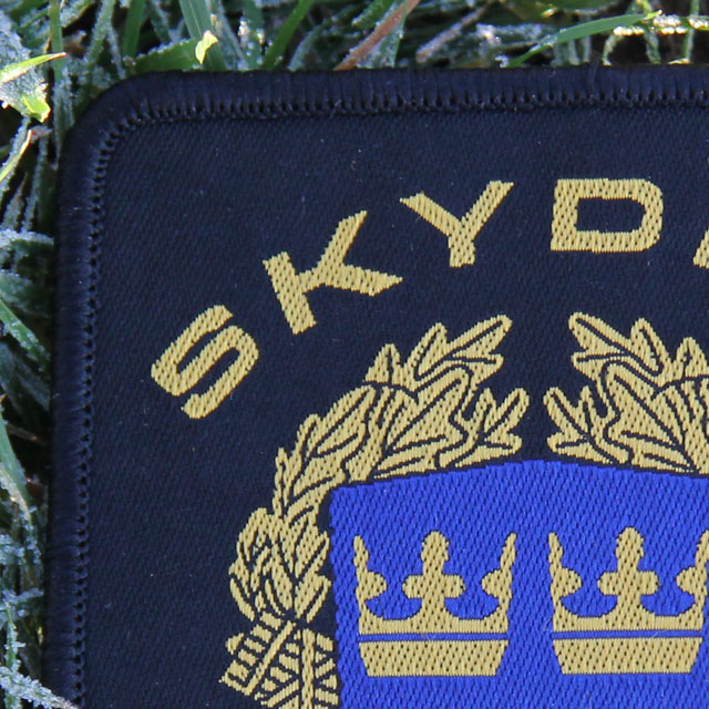Närbild på ett Skyddsvakt tygmärke kardborre Svart.