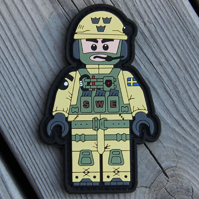Wooded background for product photo of a SWE SOG PVC Figur Patch.